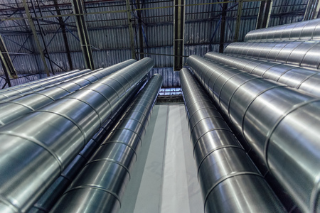 Steel pipes, parts for construction of ducts of industrial air condition system in warehouse. Bottom view.