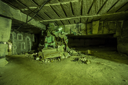 Abandoned big tunnel gallery of white limestone mine