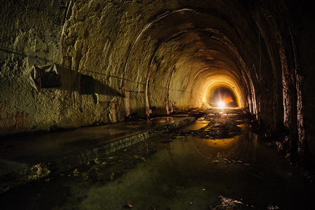 Old abandoned flooded drainage tunnel