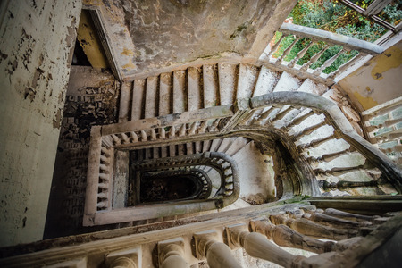 Top view of old vintage decorated staircase in abandoned mansion.