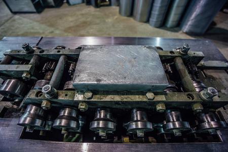 Industrial machine tool. Folding machine, close up view. Stock Photo