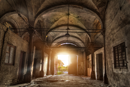 Old abandoned industrial building with vaulted celling in Gothic style. Abandoned German meat processing plant Rosenau. Stock Photo