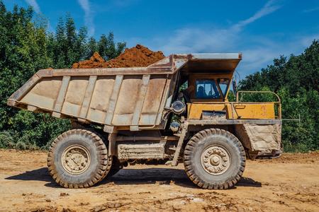 Dumper truck with soil.