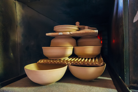 Firing of pottery in the oven. Stock Photo