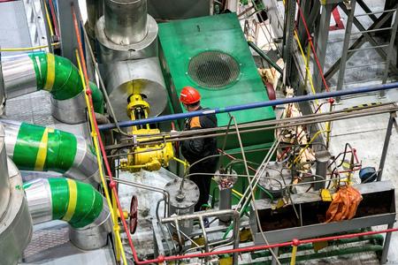 Mechanical engineer rotates control valve and adjusting compressor system. Stock Photo