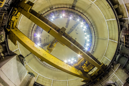 Bottom view of industrial polar rotary crane of bridge type. Construction of dome.