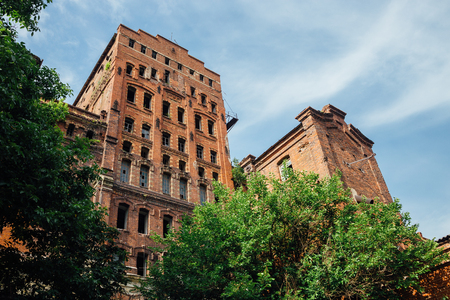 Abandoned factory of red brick - former elevator of factory of baked goods, Novorossiysk, Russia. Stock Photo