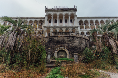 Beautiful facade of abandoned palace. Abandoned sanatorium in Gagra, Abkhazia.