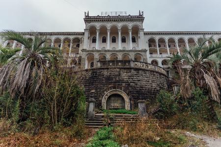 Beautiful facade of abandoned palace. Abandoned sanatorium in Gagra, Abkhazia.