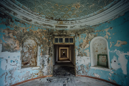 Old ruined abandoned mansion, interior of round hall.