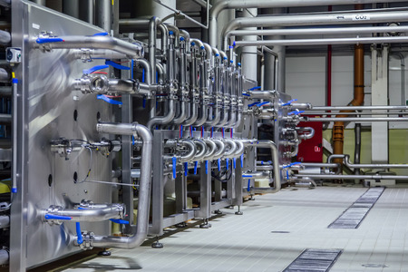 Pipeline and valve system in brewery for distribution and transportation of ingredients. Reklamní fotografie