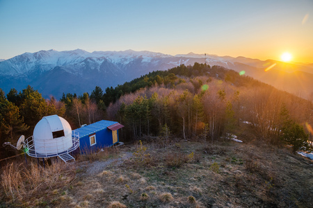 Small astronomical observatory with telescope in Caucasian mountains at the sunset. Stock Photo