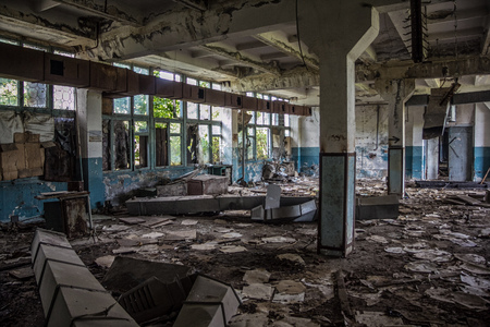 Abandoned rotten and overgrown industrial building in Sukhum, Abkhazia. Consequences of war. Stock Photo