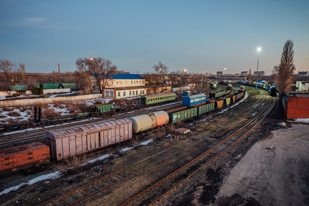 Evening railway. Commodity trains, freight wagons and cisterns. Standard-Bild