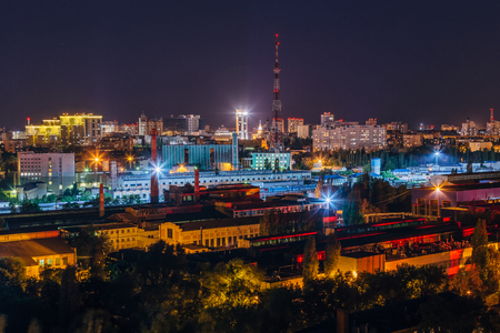 Night Voronezh cityscape, aerial view to industrial area and television broadcast tower.