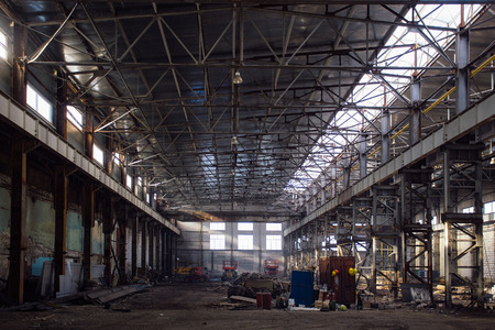 Abandoned rusted ruined industrial hall waiting for reconstruction. Former Voronezh excavator plant.