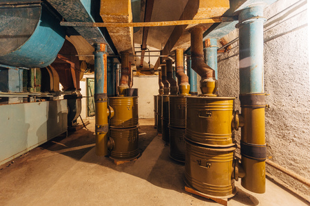 Old rusty air filtration and ventilation system in abandoned Soviet bunker or bomb shelter.