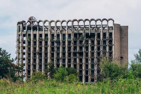 Ruined overgrown sanatorium, consequences of war in Abkhazia. Stock fotó