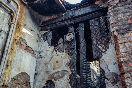 Inside burnt house. Consequences of fire.