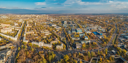 Aerial panoramic view Voronezh from height of aircraft flight. Voronezh synthetic rubber plant district in autumn.