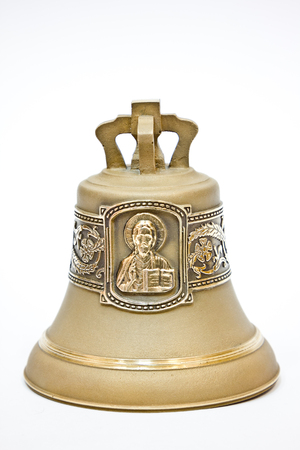 Bronze bell engraved with Jesus Christ on white background