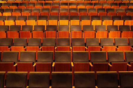 Empty auditorium of theater, cinema or concert hall, rows of chairs