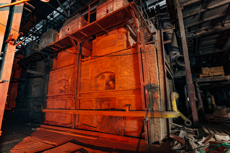 Old brick industrial stove for melting glass in abandoned  factory.
