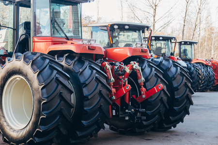 Rear view of modern agricultural tractors with hydraulic lifting frame for attaching trailed equipment. Reklamní fotografie
