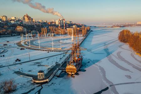 Evening Voronezh, aerial view. Admiralteiskaya embankment, monument of first Russian ship.