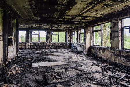 Burned interiors after fire in industrial or office building. War consequences concept.