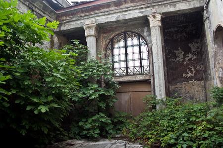 Abandoned overgrown interior of railway station in Sukhum, Abkhazia. Imagens