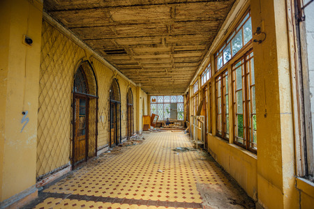 Abandoned mansion interior. Building terrace with tiled floor.