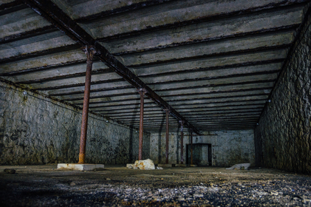 Dark and creepy dirty abandoned underground basement. Stock Photo