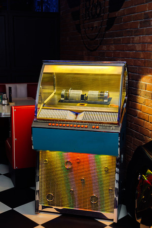 Jukebox in retro style. Automatic music player in cafe bar.