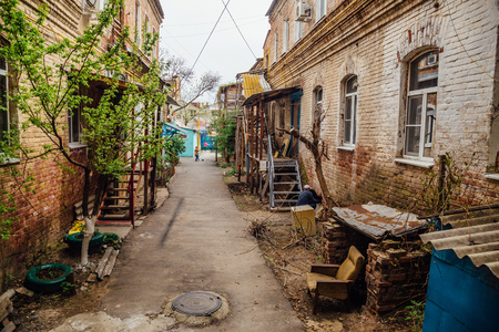 Narrow street in old poverty part of Astrakhan city in Russia.