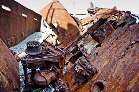 Old rusty pieces of scrap metal, parts of wrecked ship.