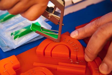 Demonstration of modern medical skin stapler on silicon sample.