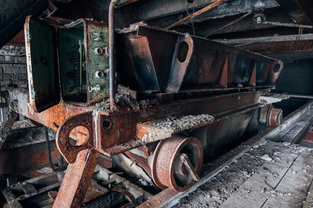 Old rusty trolley in abandoned factory