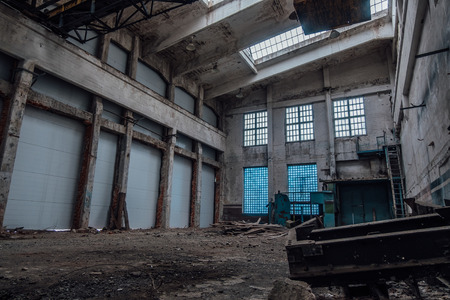 Abandoned factory interior. Empty industrial hall of workshop.