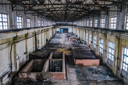 Old ruined abandoned concrete factory interior, aerial view.
