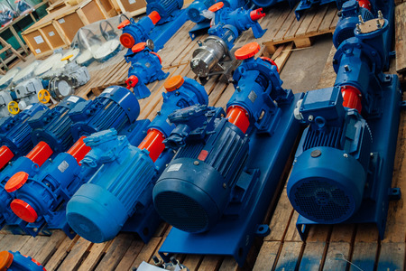 New finished electric water pumps in factory warehouse.