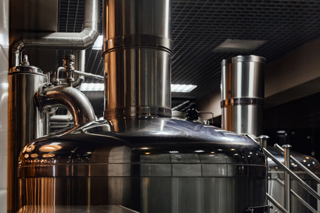 Craft beer production line in private microbrewery.