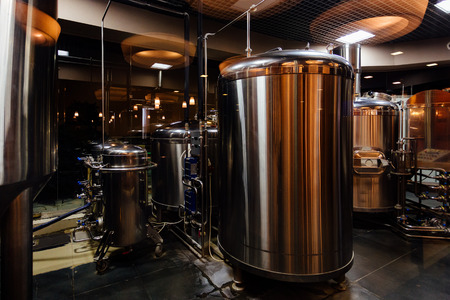 Craft beer production line in private microbrewery. Stock Photo