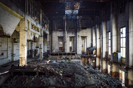 Inside burned ruined factory, consequences of fire