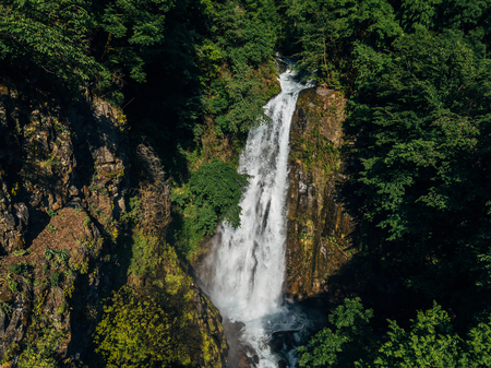 Beautiful and powerful waterfall Jirhwa in Abkhazia, aerial view.