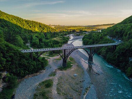Aerial view of stone bridge over gorge of river Gumista, Abkhazia.