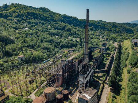 Aerial view of abandoned Tkvarcheli thermal power plant, Abkhazia, Georgia. Imagens
