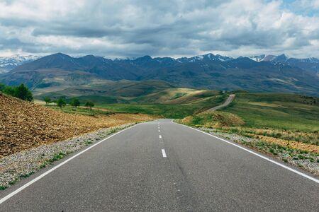 Asphalt road on mountain landscape. Travel concept. 版權商用圖片