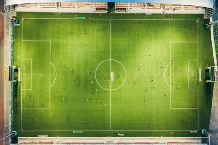 Football stadium in evening, top view from drone. Banco de Imagens - 131961719