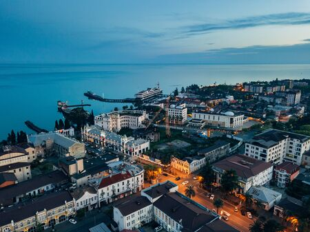 Evening resort town Sukhum, Abkhazia aerial view from drone.